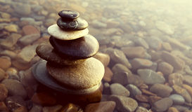 zen-balance-rocks-pebbles-covered-water-concept-60045258